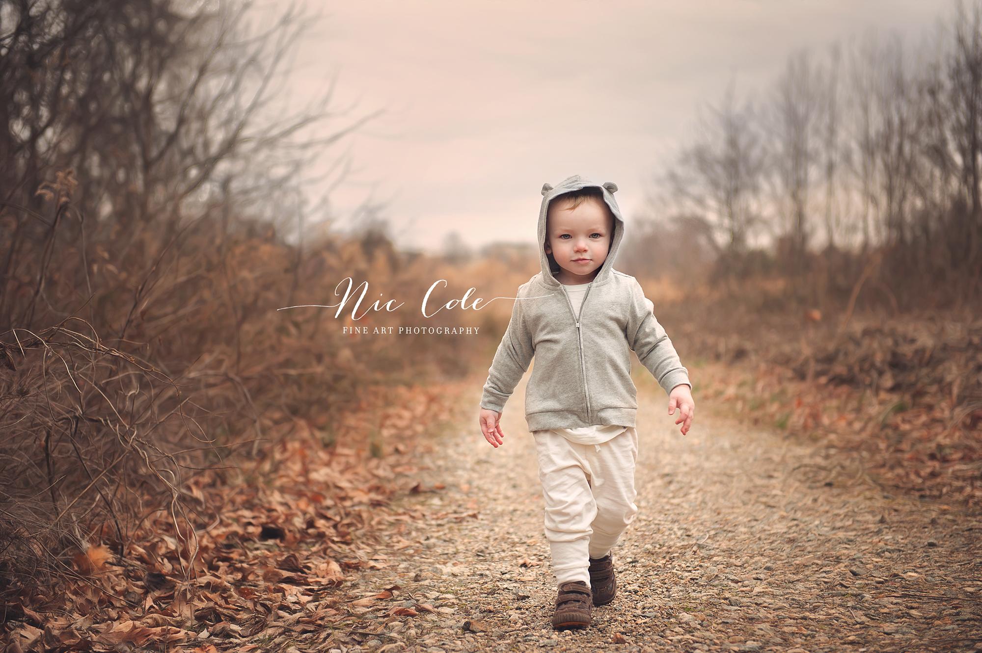 toddler walking a winter path