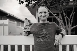 allison-gipson-black-and-white-husband-drinking-beer-outside-leaning-on-fence