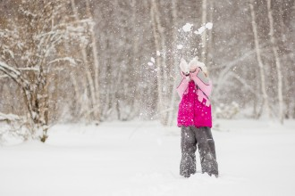 Little girl in a snow storm by tara geldart
