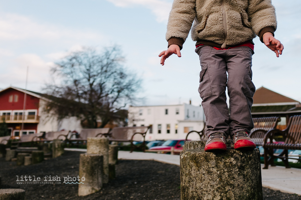 child hesitating before a jump