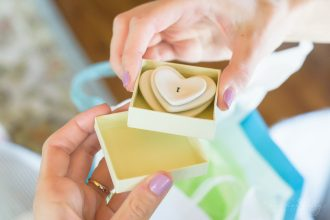 photo of bride to be holding gift from grandma. ct photographer heather kelly photography.