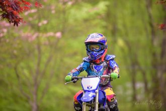 5 year old boy riding dirt bike by ct photographer heather kelly photography