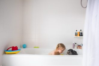 Colorful-Everyday-Life-Showing-Bathtub-Play-with-Little-Girl-and-Her-Tolerant-Shih-Tzu-Dog-