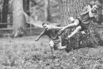 boys on rope swing laughing