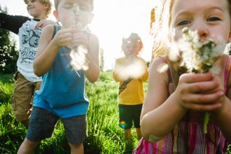 The kids blowing dandelions-1