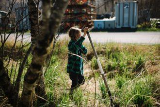 boy-using-shovel-in-garden