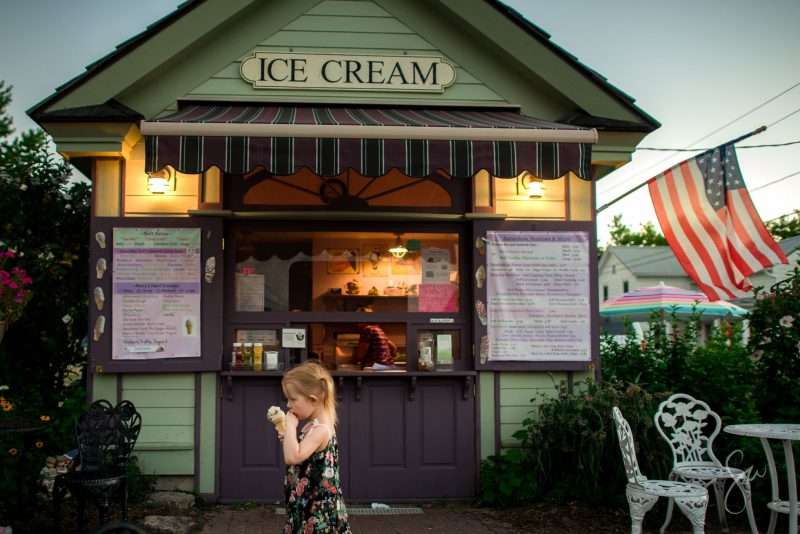 Everyday-Documentary-Americana-Photo-of-Little-Girl-at-Old-Fashioned-Ice-Cream-Stand-in-Low-Light-by-Sarah-Wilkerson-8419