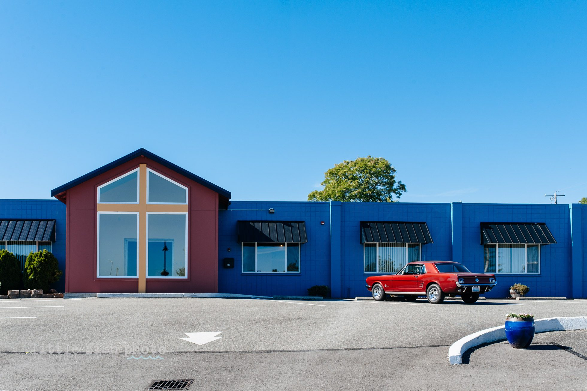 Lines and Colors of building exterior and classic car