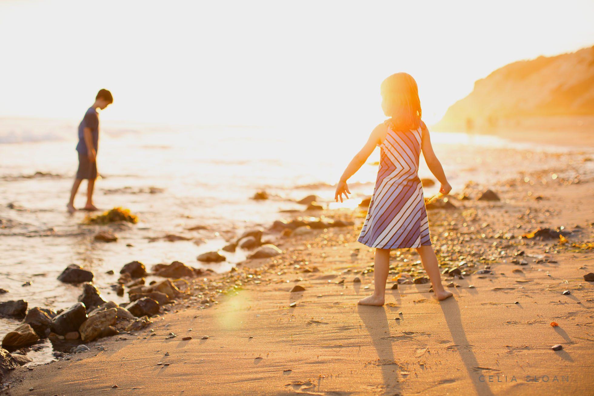 celia-sloan-child-photography-exploring-own-way-beach sunset