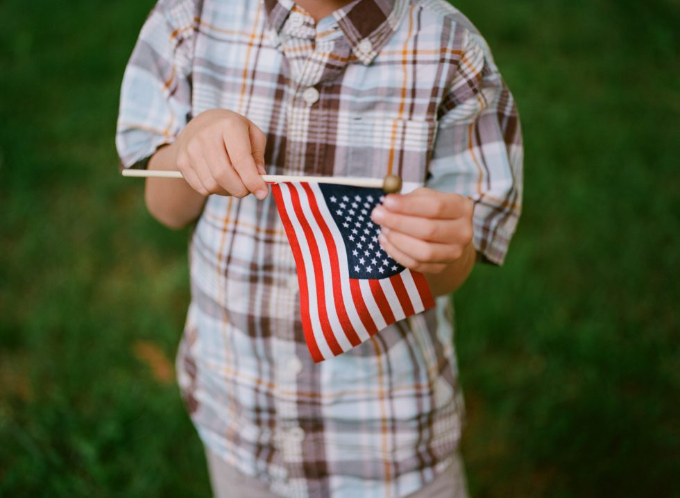 Boy holding flag