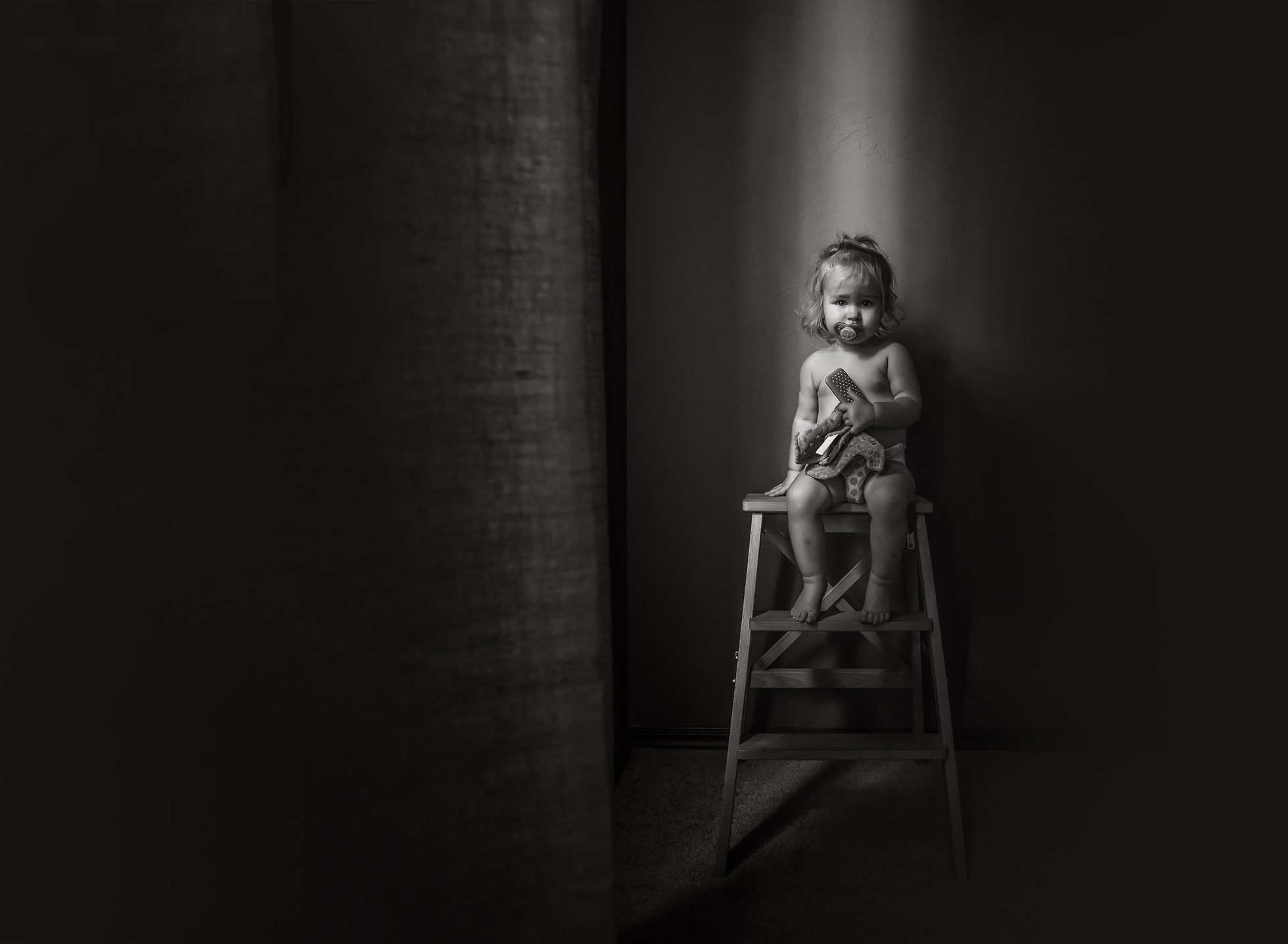 toddler days young girl sitting on ladder stool binky pacifier black and white edmond ok oklahoma city natural light photographer