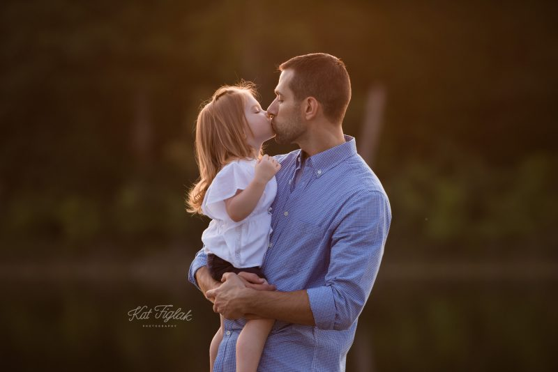 Little Girl kissing her daddy
