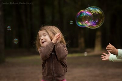 Toddler girl and a soap bubble