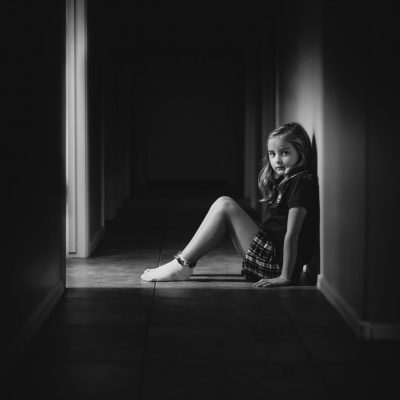 sitting in hallway black and white girlhood   %22before school%22_by Eileen Critchley