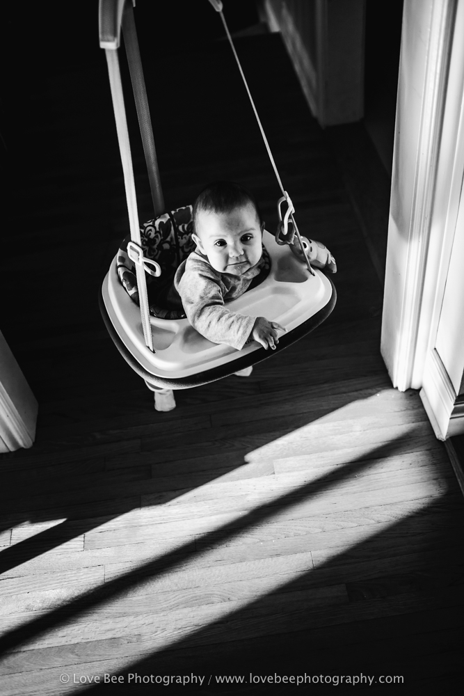 baby bouncing in swing baby photographer