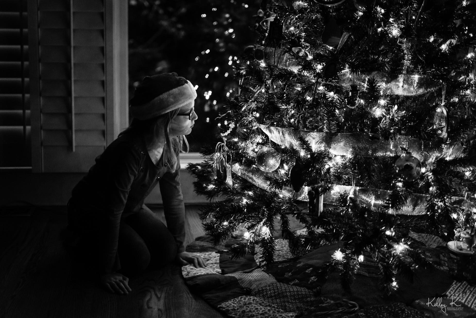 girl-by-Christmas-tree-by-KelleyKPhotography-Smyrna