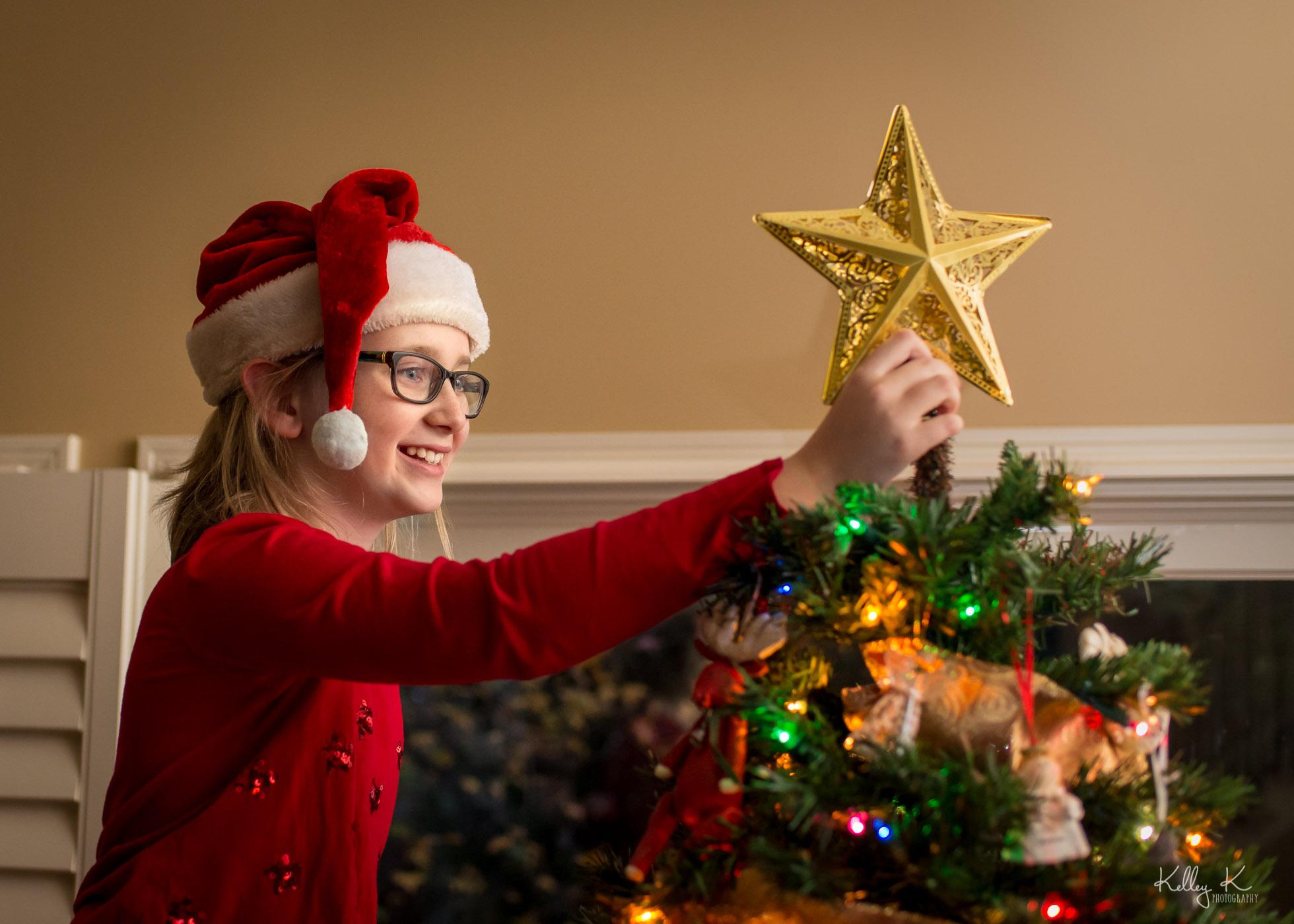 putting-star-on-tree-by-KelleyKPhotography-Smyrna