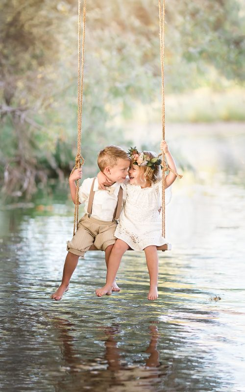 fine-art-photo-of-children-swinging-over-river-creek-by-colorado-child-photographer-lily-jean-photography