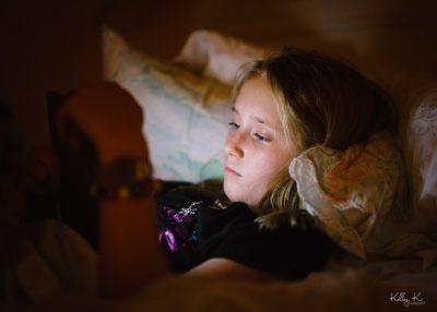 girl-kindle-ereader-in-bed-by-KelleyKPhotography-Smyrna