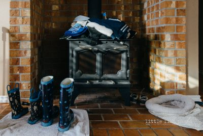 blue winter items sitting out to dry on hearth