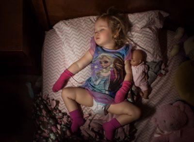 Elsa and her gloves toddler child sleeping westcott ice light lifestyle photography kate luber edmond ok oklahoma city photographer