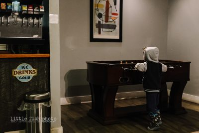 boy at foosball table - Documentary Family Photography