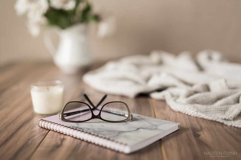 Simple-Days-glasses-planner-candle-flowers-sweater-still-life