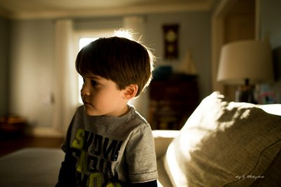boy-on-couch-in-golden-hour-backlight