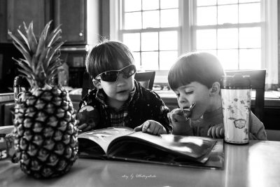 brothers-eating-and-reading-with-pineapple