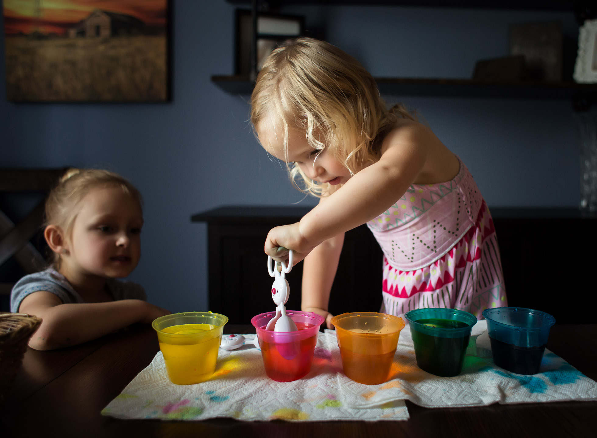 my turn toddler girl easter egg dye window light lifestyle photography edmond ok photographer oklahoma city natural light photographer kate luber photography