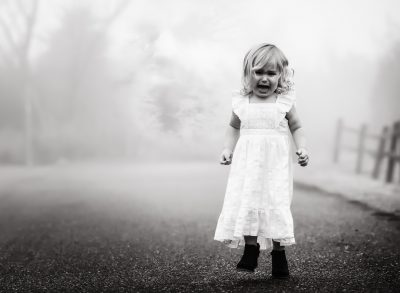 out of the fog toddler child girl black and white kate luber photography portrait horror mist creature edmond ok oklahoma city natural light photographer