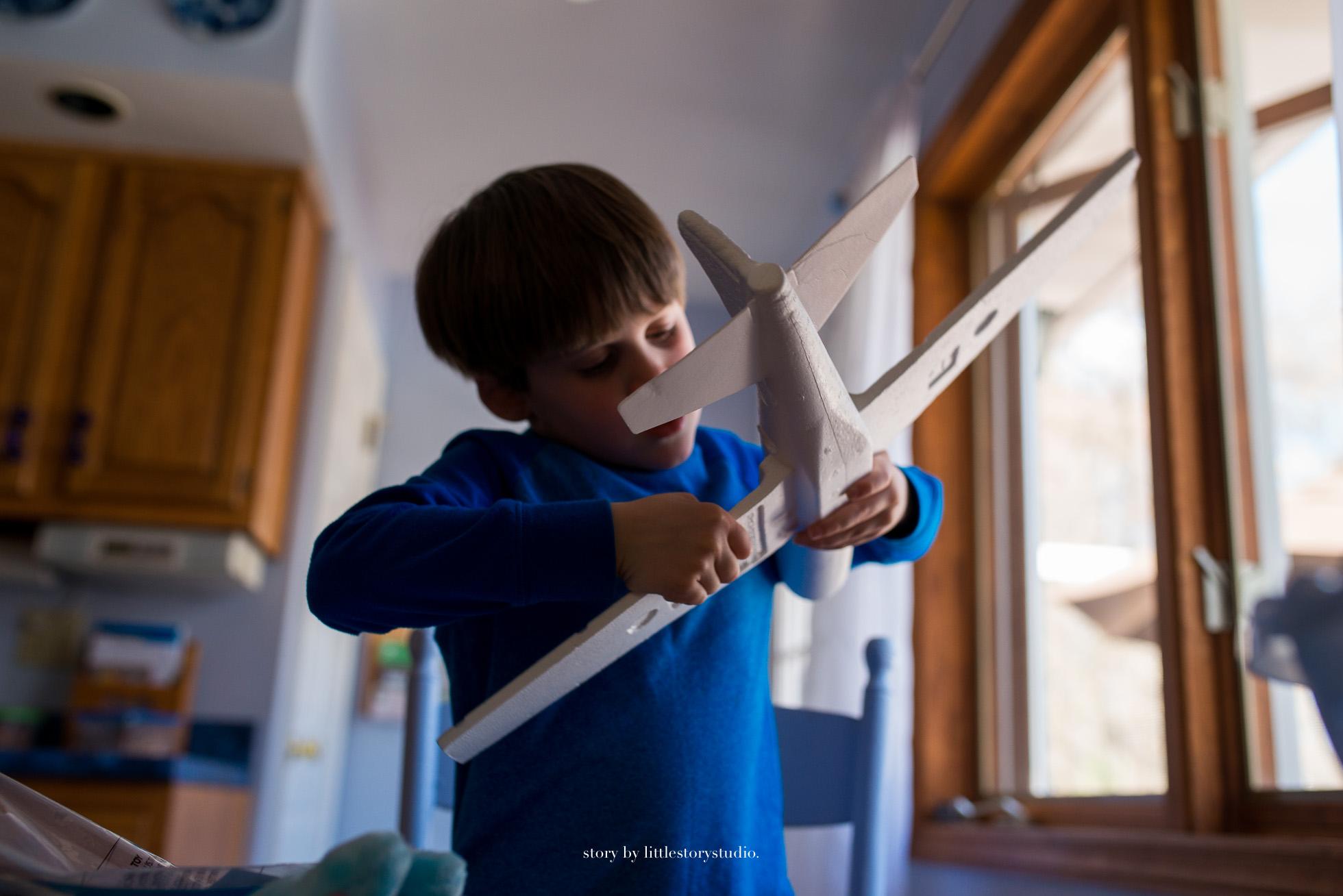 boy-putting-together-styrofoam-toy-plane