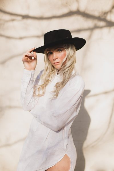 High end Commercial Portrait of blond girl in white shirt and back had by Tami Keehn