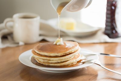 pancakes with butter and syrup on Sunday morning
