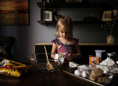 better with butter baking chocolate chip cookies girl window light lifestyle edmond ok photographer oklahoma city natural light photographer kate luber photography