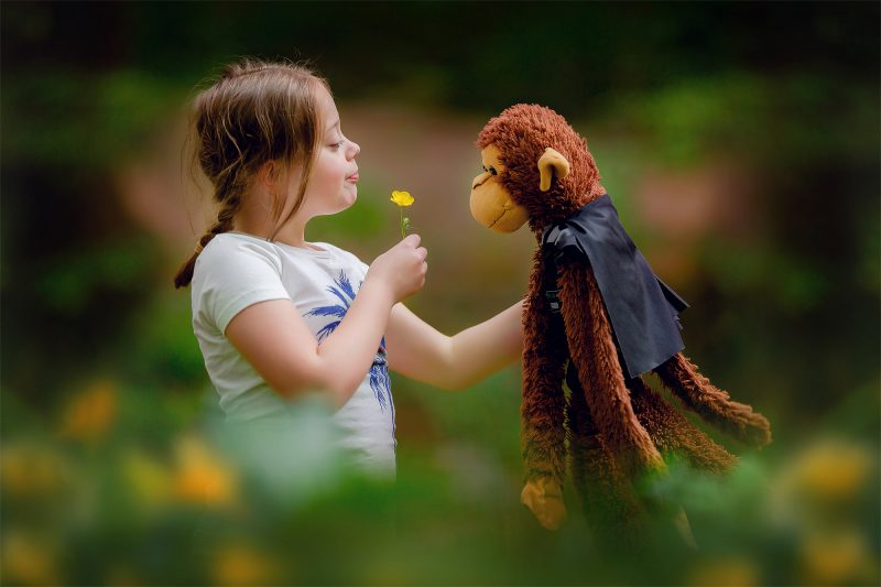 image of a little girl with a spring flower and a monkey by Willie Kers