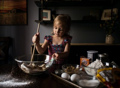 stir gently child baking window light lifestyle photography edmond ok photographer oklahoma city natural light photographer kate luber photography