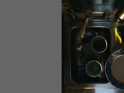 Light highlighting dishes in sink