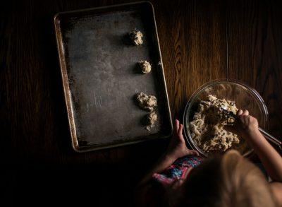 scooping cookies baking window light lifestyle photography child girl edmond ok photographer oklahoma city natural light photographer kate luber photography