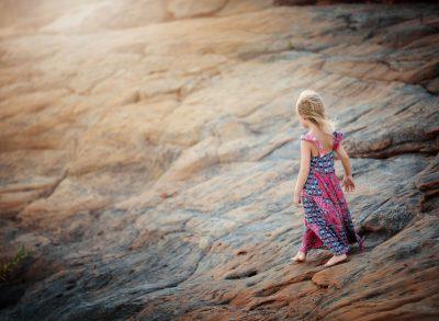 05 sandstone child girl rocks portrait faceless edmond ok photographer oklahoma city natural light photographer kate luber photography
