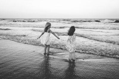 black white beach portrait of two little girls tiffany kelly