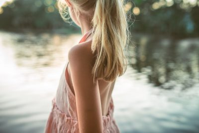 blonde girl at the edge of the lake at sunset tiffany kelly
