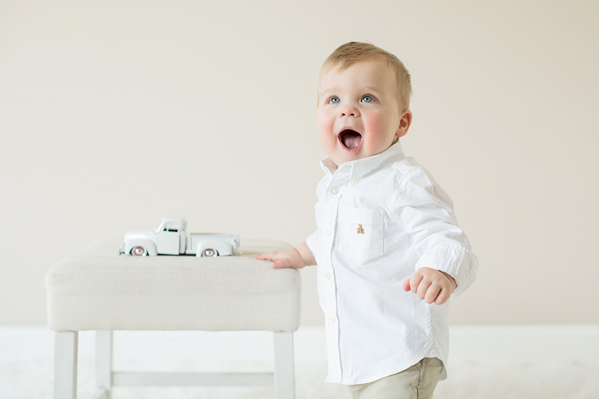 Excited little boy with toy truck.