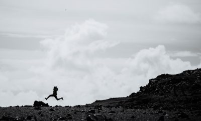 Leap at Djúpalónssandur pebble beach in Iceland by Tami Keehn