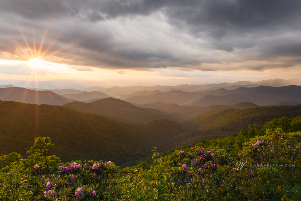 Blue Ridge Mountains with a cloudy sunset and sunburst