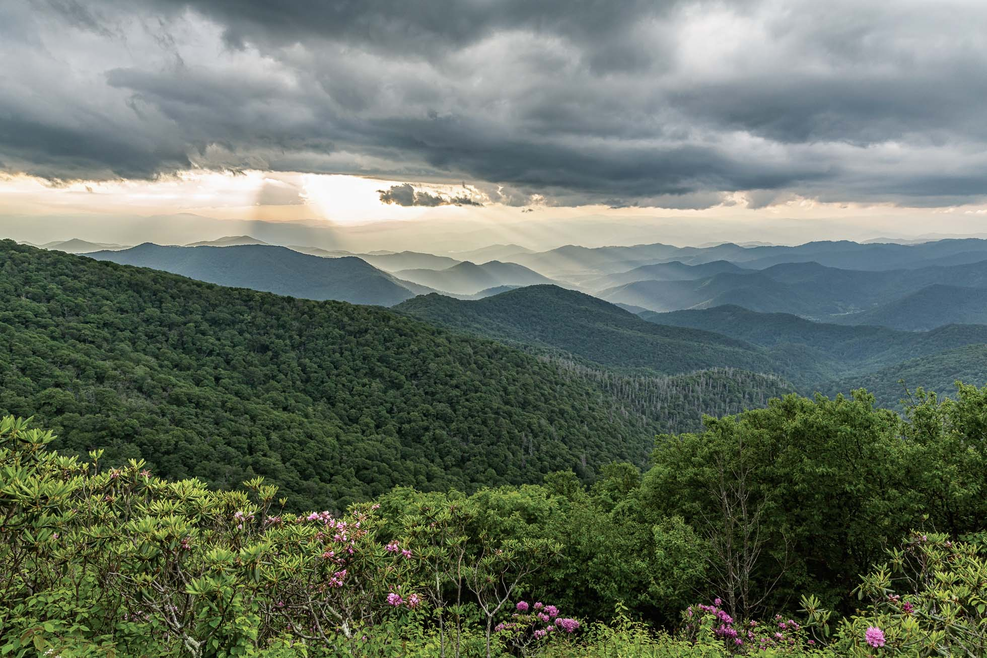 Sun rays dance on the Blue Ridge Mountains near Craggy Gardens on the Blue Ridge Parkway.