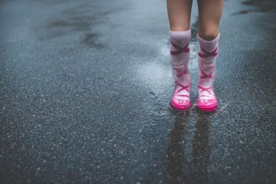 girl jumping in puddle in rain boots tiffany kelly