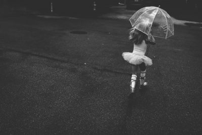 black and white ballerina running in rain with umbrella tiffany kelly