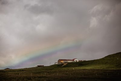 Jaw dropping rainbow after a rainstorm while traveling in Iceland by Tami Keehn