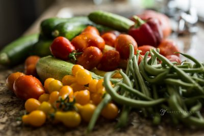 fresh vegetables from the garden on the sink drain